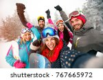 group of cheerful friends with... | Shutterstock . vector #767665972
