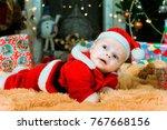 happy pretty baby lying on... | Shutterstock . vector #767668156