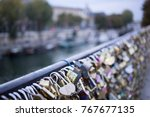 love lock on a bridge in paris  ... | Shutterstock . vector #767677135