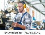 portrait of young factory... | Shutterstock . vector #767682142