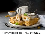 pancakes stuffed with cottage... | Shutterstock . vector #767693218