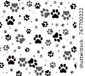paw print seamless. traces of... | Shutterstock .eps vector #767700322