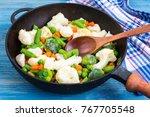 pan with frozen vegetable mix...   Shutterstock . vector #767705548
