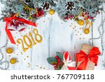 christmas wooden background... | Shutterstock . vector #767709118