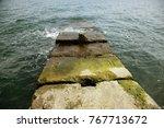 destroyed coastal concrete... | Shutterstock . vector #767713672