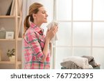 woman doing home choirs... | Shutterstock . vector #767720395