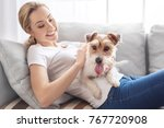 young person with dog at home... | Shutterstock . vector #767720908