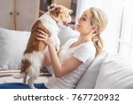young person with dog at home... | Shutterstock . vector #767720932