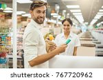man buying food products in the ... | Shutterstock . vector #767720962