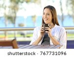 happy relaxed woman holding a... | Shutterstock . vector #767731096