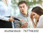 disloyal boyfriend looking at... | Shutterstock . vector #767746102