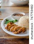 thai grilled chicken rice.... | Shutterstock . vector #767753482