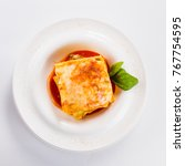"lasagna ""bolognese"" on a white... | Shutterstock . vector #767754595"