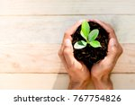 two hands of men was carrying a ... | Shutterstock . vector #767754826