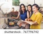 asian family is cooking in the... | Shutterstock . vector #767796742