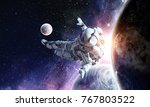 astronaut play soccer game | Shutterstock . vector #767803522