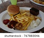 plate loaded with hamburger ...   Shutterstock . vector #767883046
