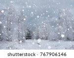 snow covered trees and heavy... | Shutterstock . vector #767906146