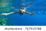 woman and snorkeling   Shutterstock . vector #767915788