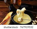 gourmet swiss fondue dinner on...   Shutterstock . vector #767919532