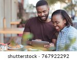 smiling young african couple... | Shutterstock . vector #767922292