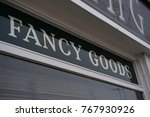 Small photo of Fancy Goods shop sign