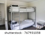 Stock photo white plain bunk bed in dormitory 767931058