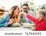happy family is enjoying pasta... | Shutterstock . vector #767943292