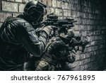 Pair of soldiers in action under cover of darkness - stock photo