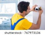 contractor installing...   Shutterstock . vector #767973136