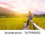 woman traveler admiring yellow...   Shutterstock . vector #767990092