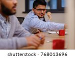 young colleagues discussing... | Shutterstock . vector #768013696