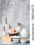 dairy products on marble table... | Shutterstock . vector #768016372