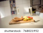 prosecco glass in kitchen with... | Shutterstock . vector #768021952