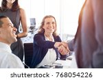 mature businesswoman shaking... | Shutterstock . vector #768054226
