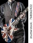 Small photo of elegant brit pop guitarist playing a british flag guitar