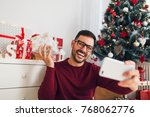 smiling young man taking photo... | Shutterstock . vector #768062776