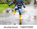 close up of kid wearing yellow... | Shutterstock . vector #768070585