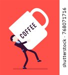 man carrying a giant coffee mug.... | Shutterstock .eps vector #768071716
