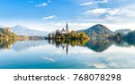 Lake Bled Slovenia. Beautiful mountain lake with small Pilgrimage Church. Most famous Slovenian lake and island Bled with Pilgrimage Church of the Assumption of Maria and reflection in calm water.