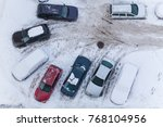 car under the snow in a parking ...   Shutterstock . vector #768104956
