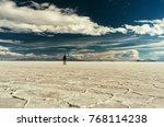 man walks at salar de uyuni in...   Shutterstock . vector #768114238