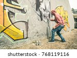 street artist painting colorful ... | Shutterstock . vector #768119116