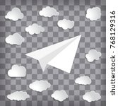 white paper plane with clouds...