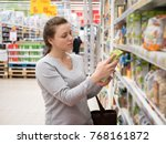 woman checking food labelling... | Shutterstock . vector #768161872