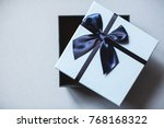 blue open gift box top view.... | Shutterstock . vector #768168322