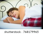 relaxed girl in pyjamas taking... | Shutterstock . vector #768179965