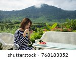 woman drinking coffee and... | Shutterstock . vector #768183352