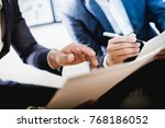 business partners discussing... | Shutterstock . vector #768186052