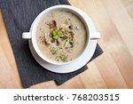 a bowl of creamy mushroom soup | Shutterstock . vector #768203515